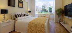 简单壁纸打造时尚的卧室效果