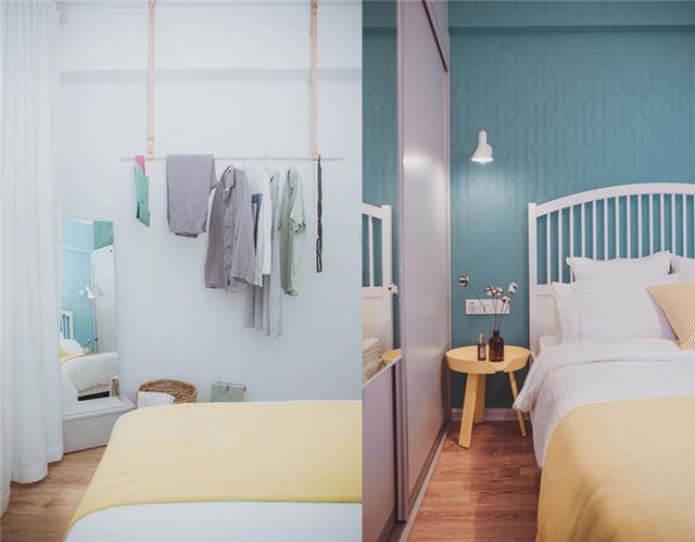 主卧房间的墙角处放置着全身镜和金属收纳挂衣架