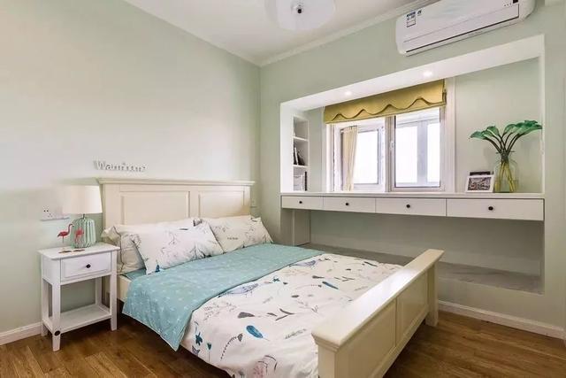 儿童房墙面均刷成淡淡的绿色