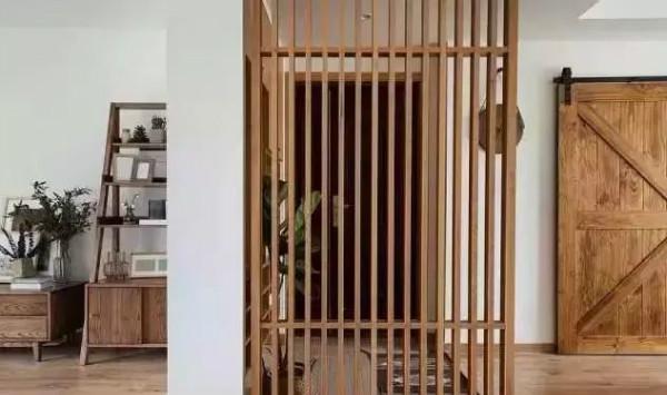 三室两厅 风格:现代原木风 玄关下沉式的设计,让入户形成一个小台阶