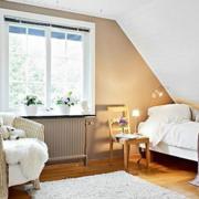 欧式简约风格阁楼卧室沙发装饰
