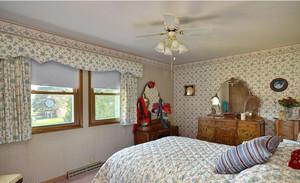 春意盎然的田园风格卧室窗帘装修效果图