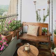 美式简约风格阳台原木浅色吊椅装饰