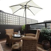 后现代风格农村阳台藤椅装饰