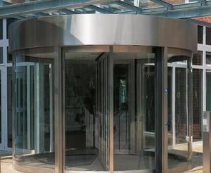企业办公楼大厅手动旋转门装修效果图