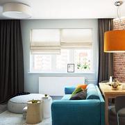公寓客厅蓝色沙发摆放