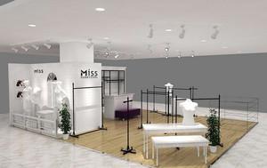 现代小型服装店产品展示柜台效果图