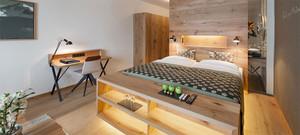 温馨的小户型现代都市卧室背景墙装修效果图