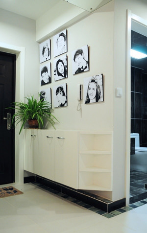 现代美式风格大户型玄关照片墙装修效果图