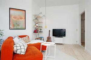 北欧风格温馨橘色客厅沙发设计装修效果图