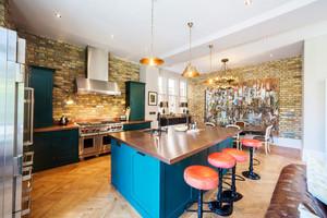 后现代风格大户型时尚厨房吧台装修效果图赏析