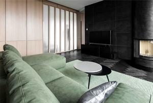 56平米简约风格单身公寓设计装修效果图,浅绿色的沙发设计和黑色的背景墙装修,营造一个精美优雅的时尚客厅,没有过道的装饰,看起来简单舒适。