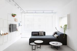 56平米简约风格单身公寓设计装修效果图,客厅装修采用黑色的布艺软装沙发设计,精美的茶几装饰,客厅电视背景墙采用创意的组合架设计,美观方便。