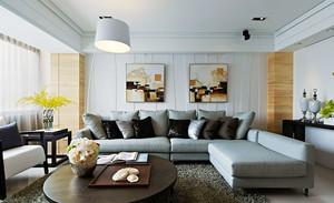 现代风格时尚精装三室两厅室内设计装修实景图,浅灰色的布艺沙发设计,简单的圆形茶几设计,精美的装饰画,让室内看起来温馨舒适。