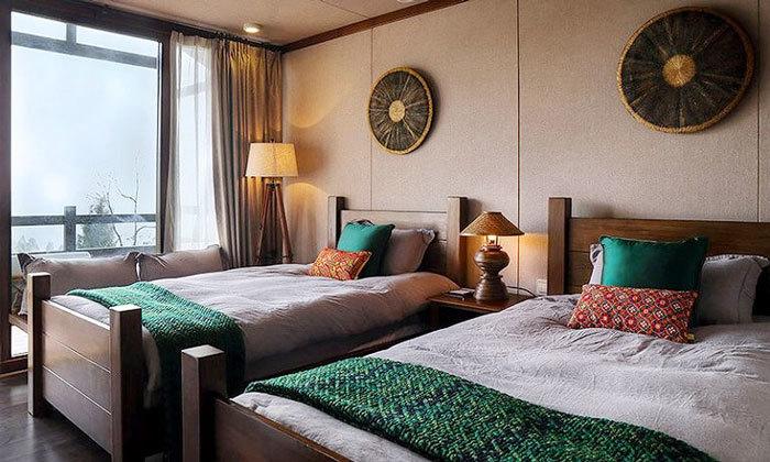 东南亚风格宾馆标准间装修效果图