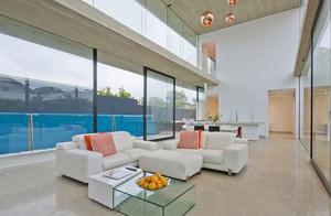 2018年现代风格别墅入户花园效果图,这是现代风格的客厅,整体的居室都是以浅色为主,使得整体的空间变得非常的宽敞大方,有气场。
