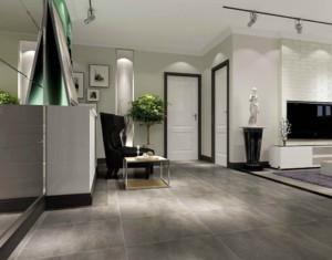 灰色的地板与木质的墙面在色彩上给人冲击感,表达主人特立独行的个人风格。高背的皮质L型沙发紧靠墙壁,给人舒适又有安全感。
