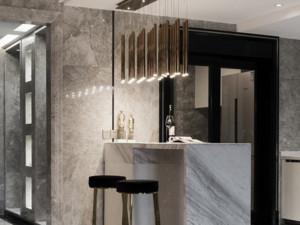 此家庭的装修偏向于轻奢风,以现代风格为主进行设计。其吧台是靠墙安装的,为灰白色的大理石材质。吧台上方的吊灯造型十分别致,在起到照明作用的同时,还有很好的装饰效果。