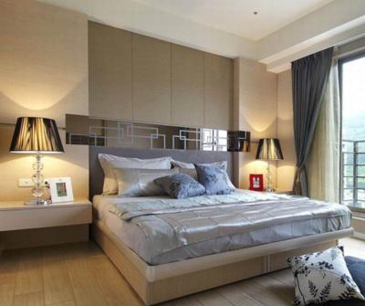 90平现代卧室背景墙装修设计效果图
