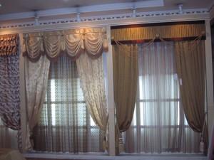 窗帘专卖店加盟店装修效果图,商场窗帘专卖店效果图